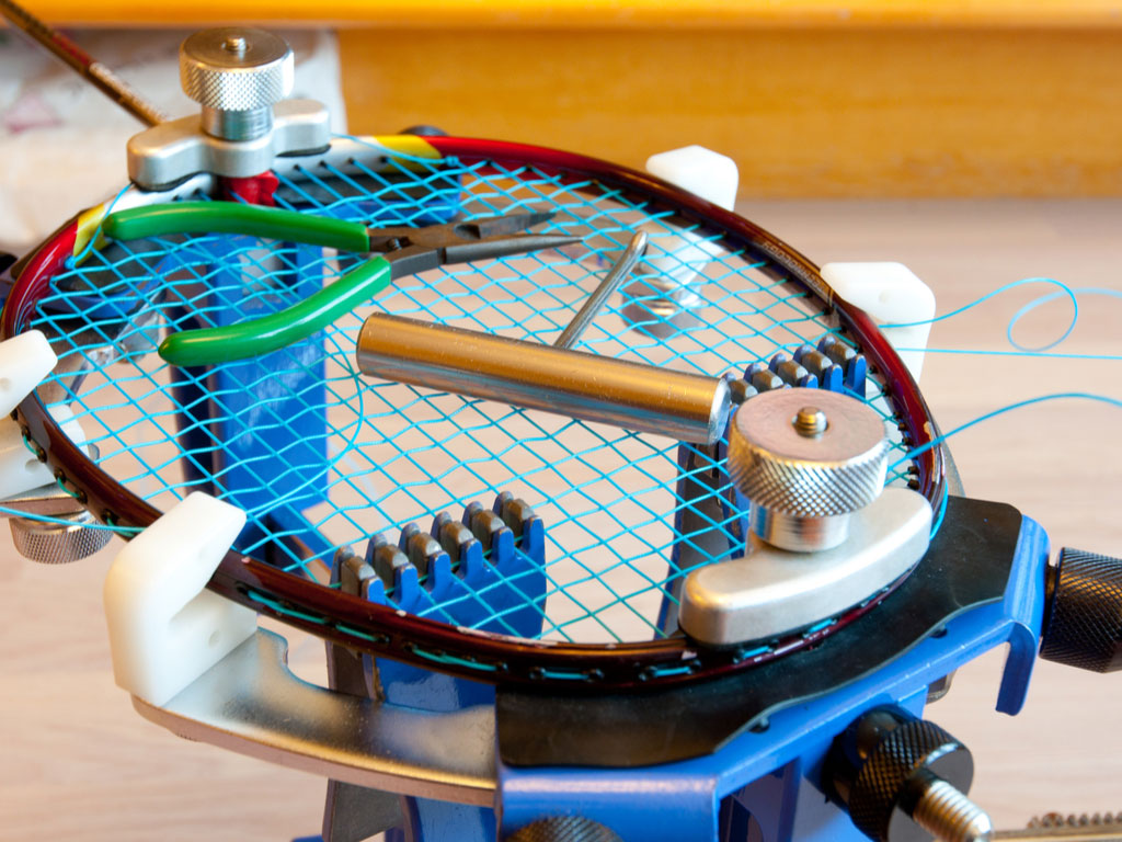 a racquet getting restrung